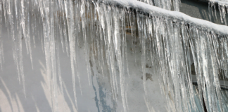 Ice dam, as seen on the side of a home in the winter