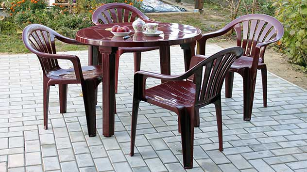 Plastic patio furniture on a paver patio