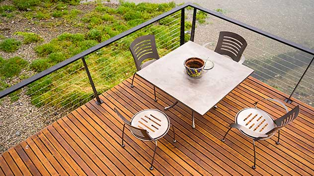 Steel dining set on a wood plank patio