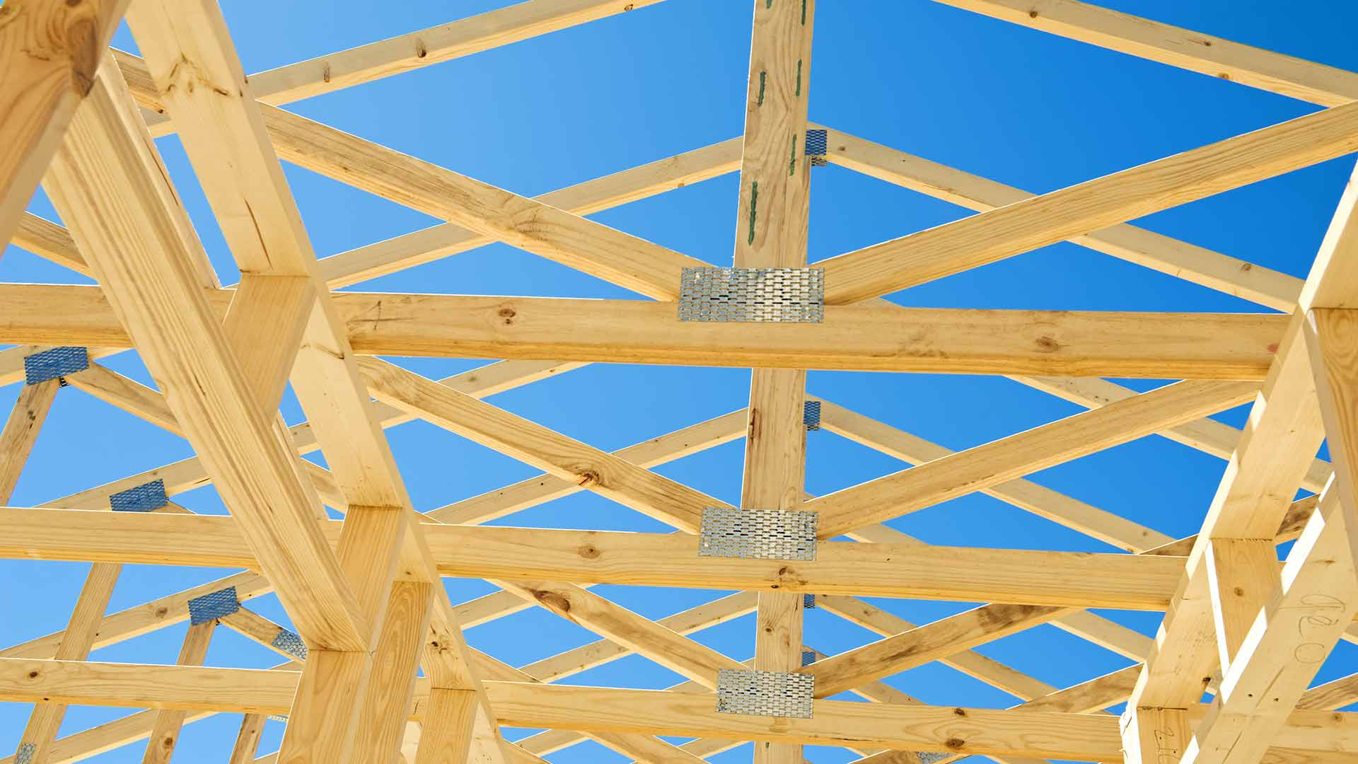 Construction site of home with timer roof truss