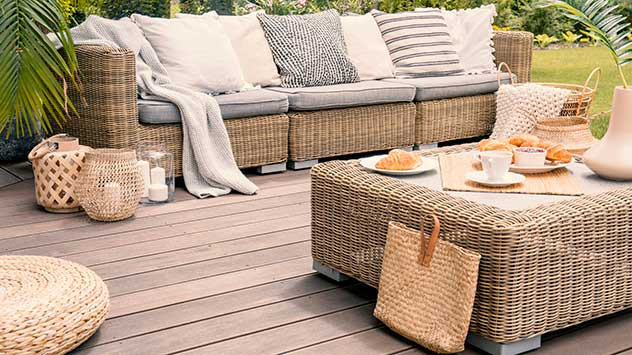 Wicker sofa on a wood plank patio