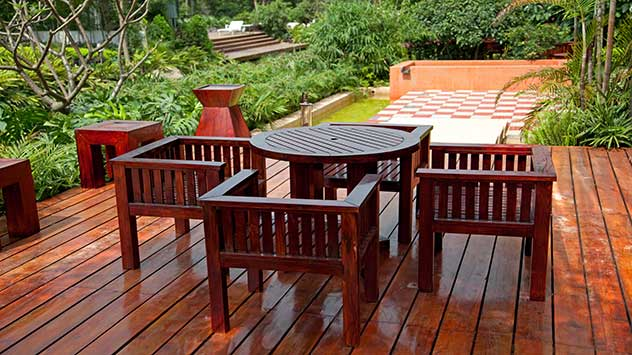 Wood patio furniture on a wood plank patio