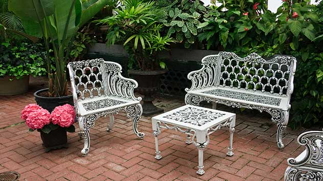 Wrought iron furniture on a brick patio