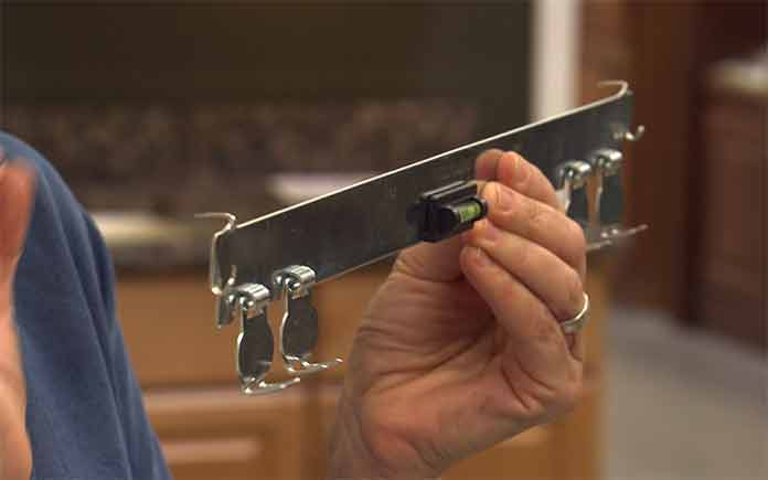 High and Mighty Picture Hanger is great for hanging heavy objects without the need of a stud