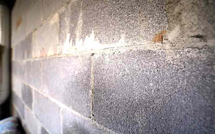 Basement block pushed by a beam