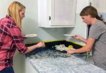 Chelsea Lipford Wolf and homeowner paint laminate countertop