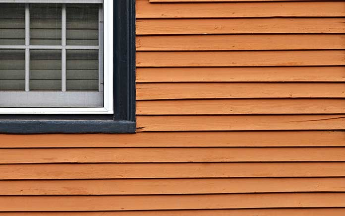 Clapboard siding that's split, ugly and needs repair