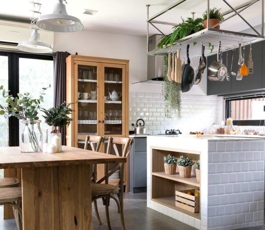 Cozy small kitchen with blue curtains