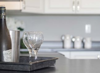 Home staging featuring a kitchen tray with wine glasses