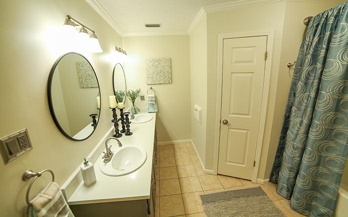 Master bathroom with quartz countertop and round mirrors