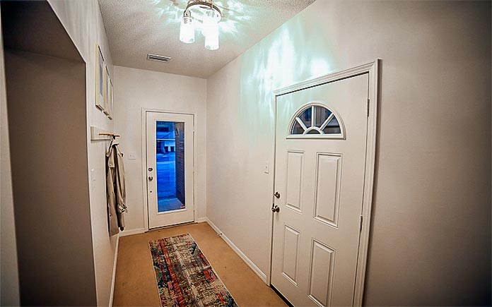 Mudroom, after renovation with new exterior door leading to the garage