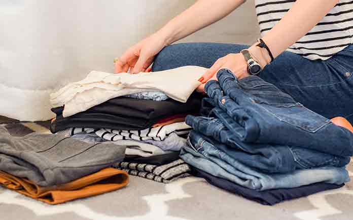 organizing clothes is an important part of de-cluttering