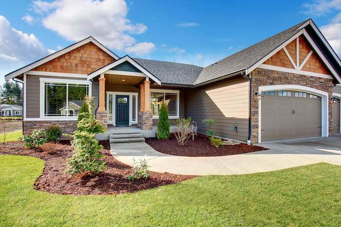 Front of beautiful home with shingles and stone detail