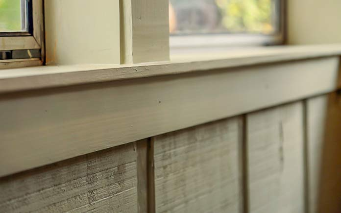 Sunroom makeover with reverse board and batten siding