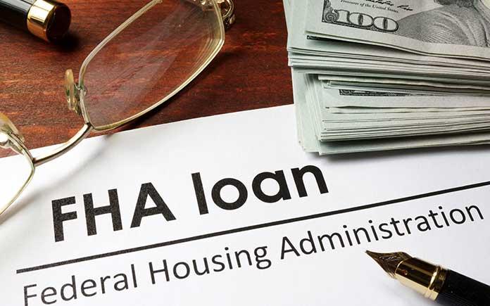 FHA loan application on desk