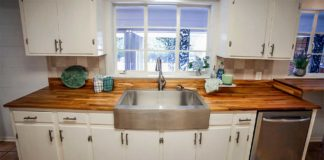 Kitchen design featuring a butcher block countertop and stainless steel apron sink