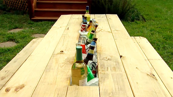 Picnic table with drink trough