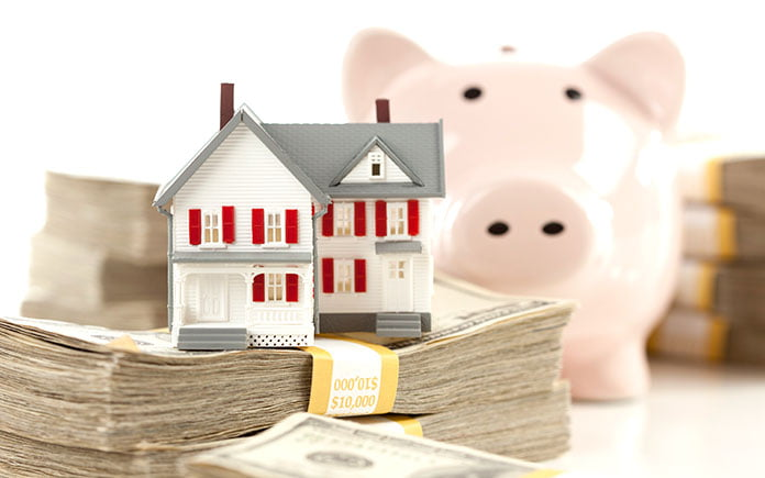 Piggy bank and stacks of cash for down payment