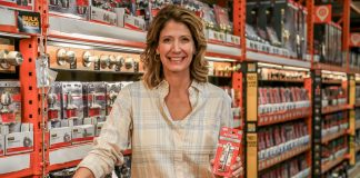Jodi Marks with the AjustLock gate lock at The Home Depot in Mobile, Alabama