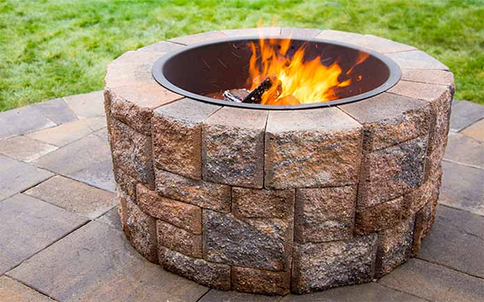 Paver fire pit with open flame