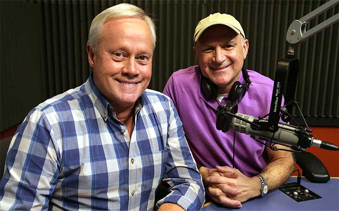 Danny Lipford, smiling with Joe Truini, in the Today's Homeowner Radio Show recording booth.