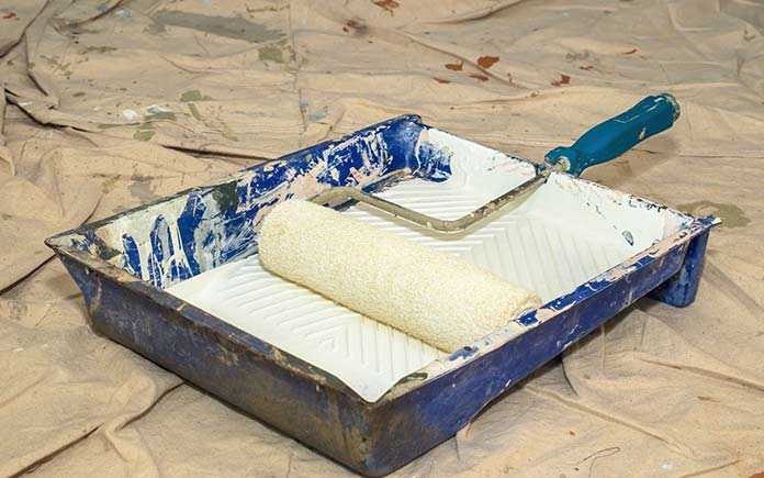 Drop cloth with paint on it during home renovation