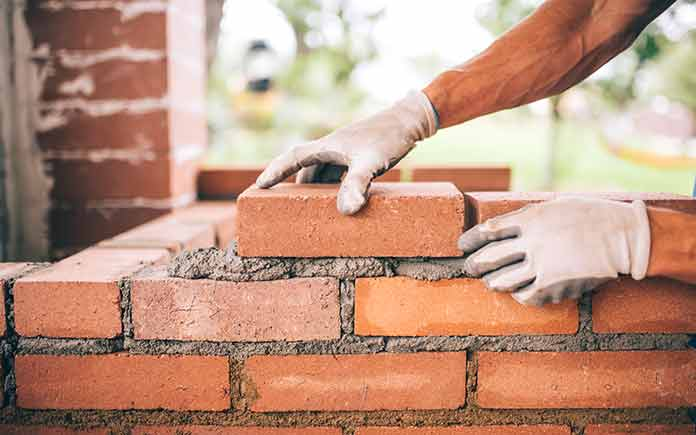 laying bricks for a new home
