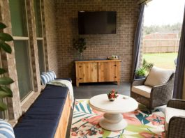 Patio after makeover with window seat, area rug and cedar buffet