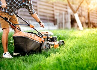 Man preparing to mow lawn