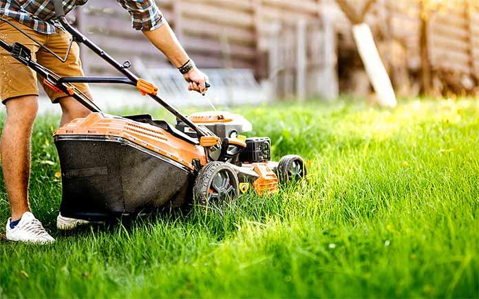 Man preparing to mow lawn