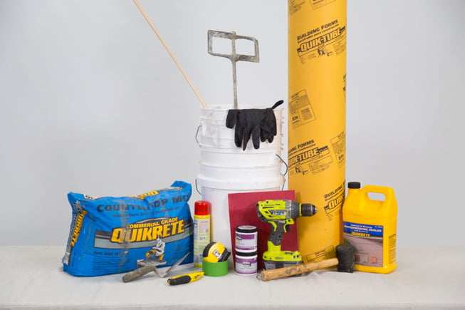 materials used to make concrete stools, pictured posed on a white backdrop