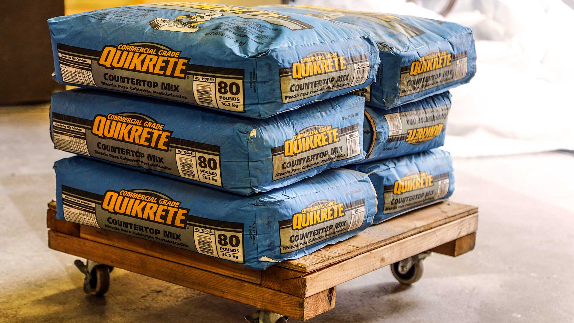 Quikrete Concrete Mix in bags on rollers in storage