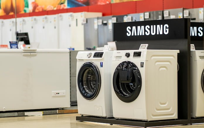 Samsung washing machines displayed in the showroom of a commercial store. Household items Samsung brand exhibited for sale.