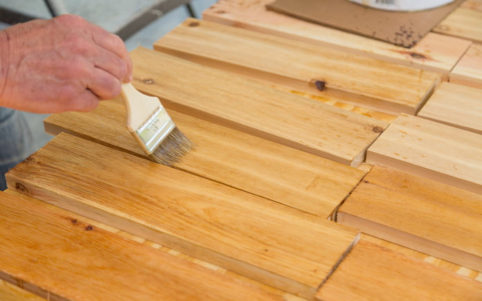 Sealing the slats with clear spar varnish