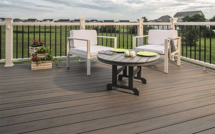 Trex decking, Rocky Harbor style, shown at eye level along with two chairs and a table