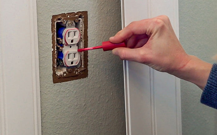 Applying lip gloss to an electrical outlet