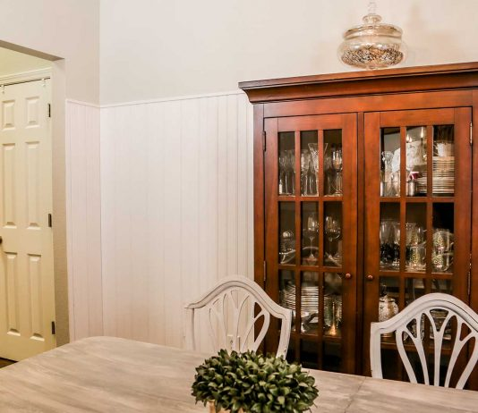 Beadboard wainscoting installed in dining room