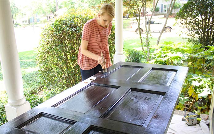 Chelsea Lipford Wolf paints an entry door