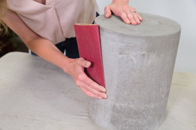Chelsea Lipford Wolf sands concrete with sandpaper