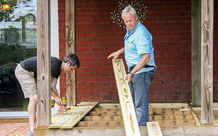 Danny Lipford removes rotting deck boards from summer home