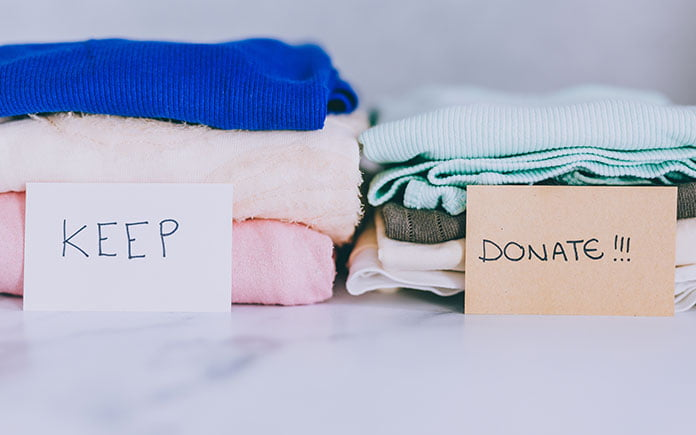 Piles of clothes for keeping or donating