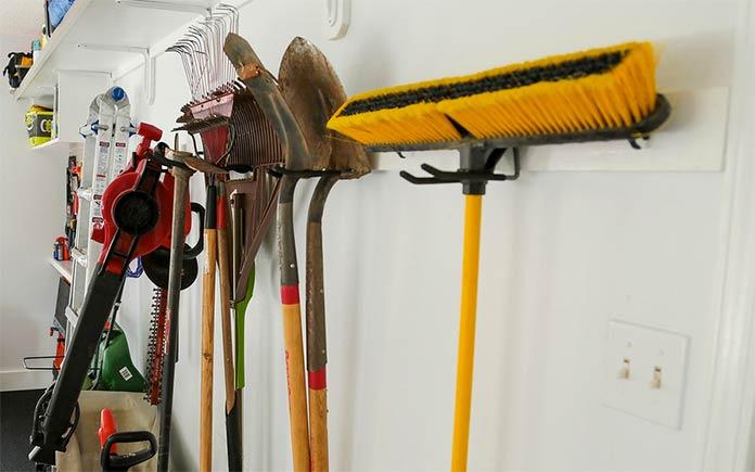 Wall-mounted yard tool storage