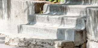 Damaged concrete steps at a house