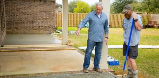 Danny Lipford looks at a wet concrete patio in production at the job site