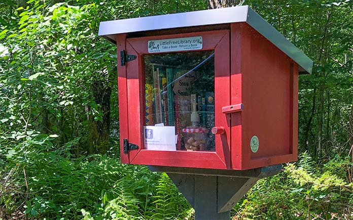 Red Little Free Library with door closed in Rhode Island