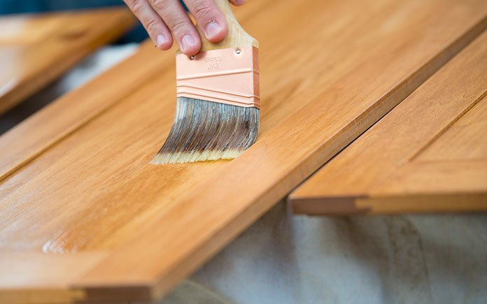 Staining kitchen cabinets with a paintbrush