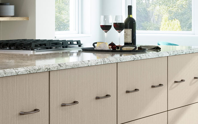 European-style cabinets in a dream kitchen with two glasses of wine on the countertop.