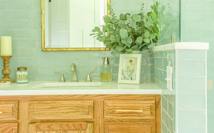 Chelsea Lipford Wolf's master bathroom addition with blue tile walls and a wood vanity