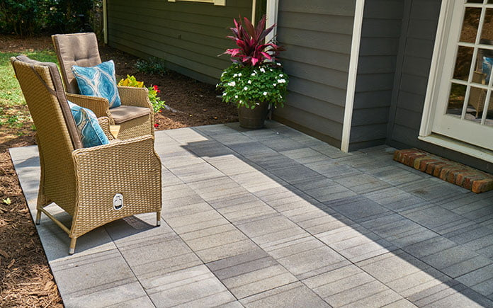Side view of Pavestone Avant Linear pavers, as seen on a gray patio during a sunny day