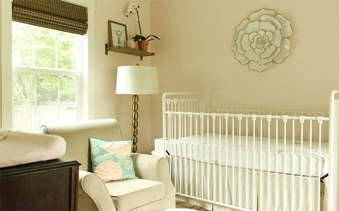 Nursery with soft pink walls in Chelsea Lipford Wolf's home